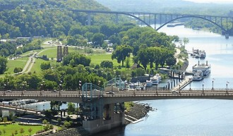 A view of St. Paul, with the Wabasha Bridge over the Mississippi River in the foreground. At left is Harriet Island Regional Park and at top right is the Smith Avenue High Bridge. (Pioneer Press: Scott Takushi)