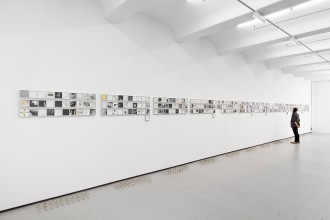 """Vibha Galhotra, """"365 Days"""" (2015), 365 drawings made of ink, photocopy, collage and sediment on paper, and 365 glass bottles, 4 1/2 x 4 1/2 x 1 3/8 in (each framed drawing), 2 3/4 x 1 3/4 diameter (each glass bottle), overall installation dimensions variable (click to enlarge)"""