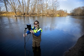 Sarah Jo Schmitz of the Sauk River Watershed District used a meter to track the river's flow south of St. Joseph, Minn. Photograph Brian Peterson, Star Tribune