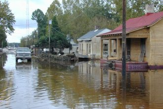 The muddy deserted streets of flood ravaged Princeville, North Carolina stand in silent testimony to the destruction wrought by the Tar River. Princeville, NC 9/28/99. Photo By Dave Saville/FEMA News Photo.