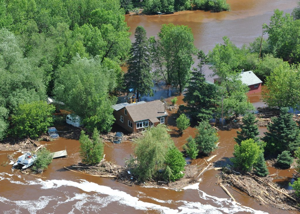 DULUTH, Minn. - An aircrew from Coast Guard Air Station Traverse City, Mich., conducts a damage-assessment overflight of severely flooded areas of Fond du Lac June 24, 2012. Coast Guard Air Station Traverse City's flights provided search and rescue assistance as well as key witness to the extent of the flooding. U.S. Coast Guard photo by Petty Officer 1st Class Matthew Schofield.