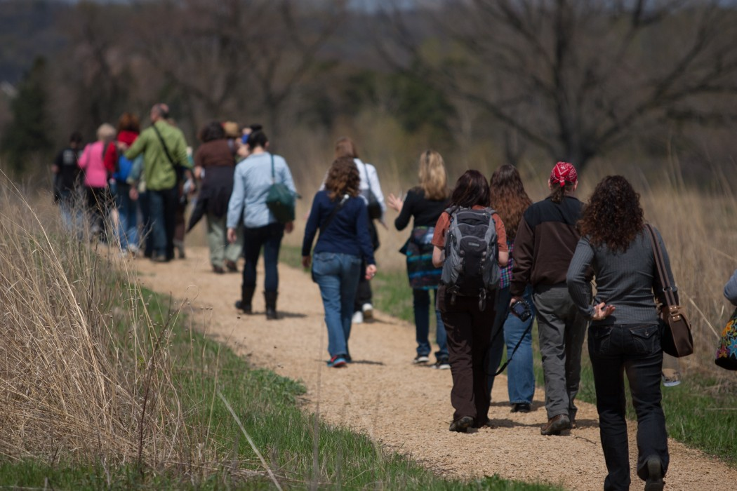 People walking between sites at Oheyawahi/Pilot Knob . Photo by Michael Murray; courtesy of the Minnesota Humanities Center.