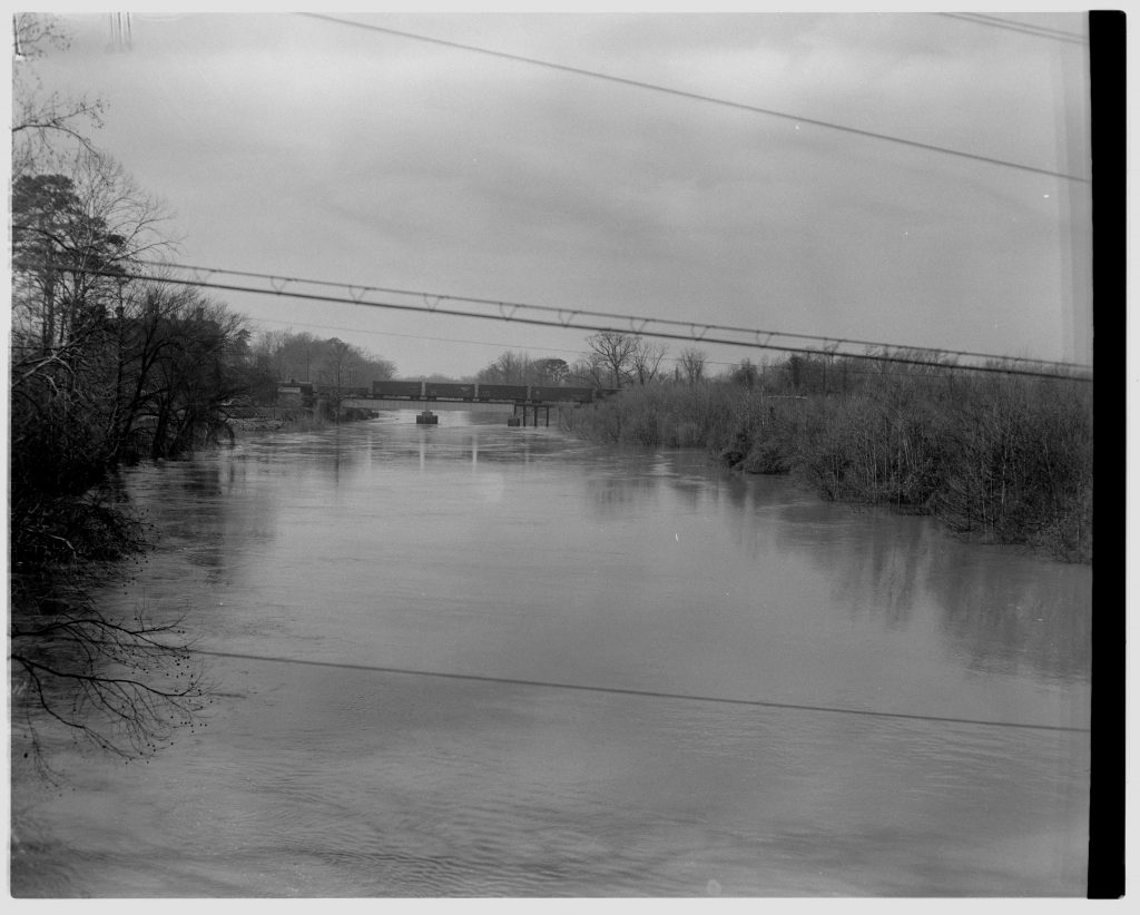 Tar River water level elevated almost to reach the bridge. Date from negative sleeve. Daily Reflector (Greenville, N.C.) January 26, 1954.