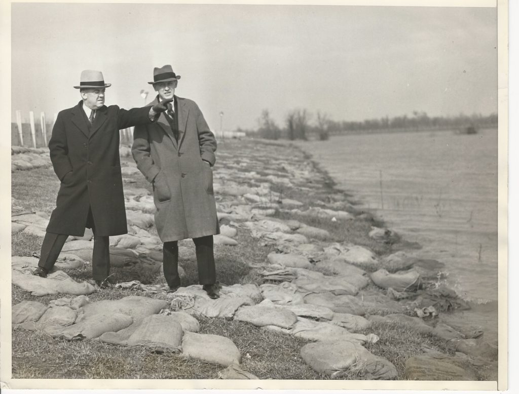 Chief Engineer Edward Murphy Markham on the St. Francis River levee in Arkansas, with Harry Hopkins, Head of the Roosevelt Special Flood Commission, February 1, 1937. Image reverse available. Image used with permission, Jeff Daly.