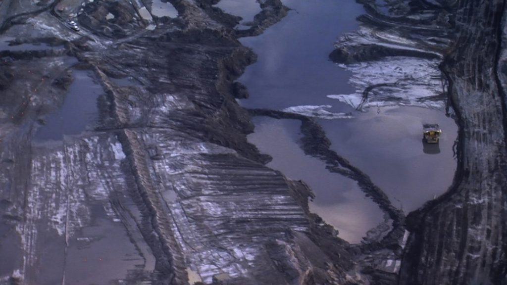 Ursula Biemann, video still from Deep Weather (2013). Aerial shot of Oil Sands. Courtesy of the artist.