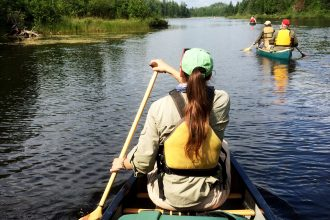 Paddling the narrows of Splash Lake from Ensign Lake in the Boundary Waters Canoe Area Wilderness (BWCAW) in northeast Minnesota, a pristine, yet rugged wilderness established by Congress in 1978. The 1,000,000+ acre BWCAW is enjoyed by some 200,000 visitors annually. Photo by Alex Messenger. Courtesy of Messenger Photography.