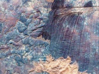 """Detail of """"Otokaheya"""" (In the Beginning), quilted fabric, Gwen Westerman, artist. Image courtesy of the artist."""