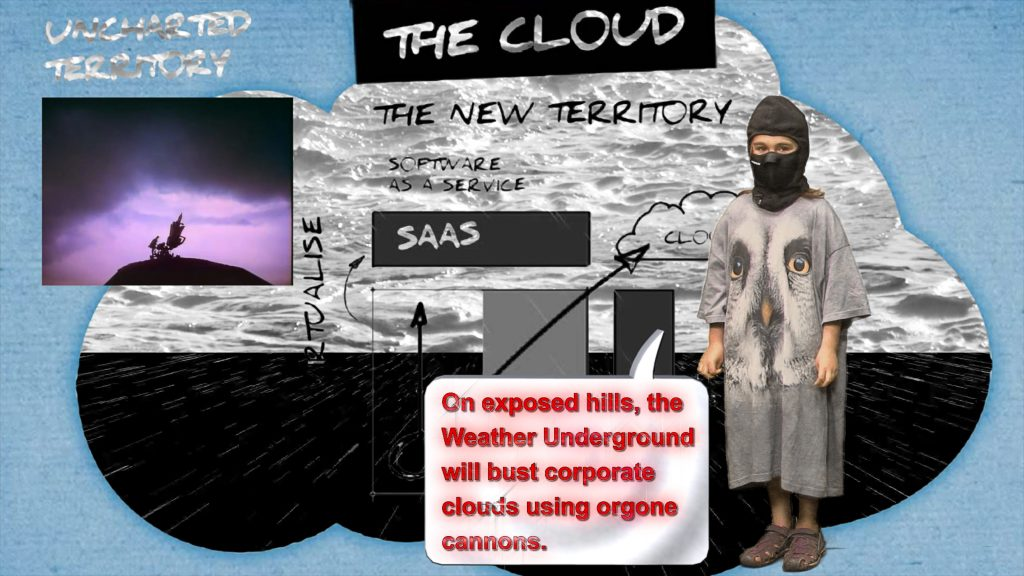Hito Steyerl, video still from Liquidity Inc, 2014. A child wearing a ski mask and an oversized shirt with an owl on it has a speech bubble saying 'On exposed hills, the Weather Underground will bust corporate clouds using orgone cannons.' Courtesy the artist. © Hito Steyerl.