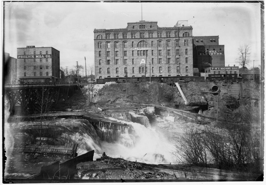 Figure 2. Pillsbury A Mill, Phoenix Mill, and Pillsbury elevator and machine shop above St. Anthony Falls, circa 1900. Image courtesy of the Minnesota Historical Society.