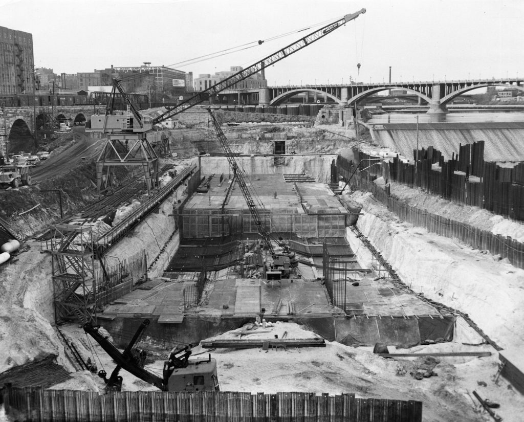 Figure 3. Construction of the Upper St. Anthony Falls lock, 1960. The current horseshoe-shaped hydro-electric dam, completed in 1963, is 49 feet in height (US Army Corps of Engineers 2016a). Photo by Dale L. Sperline, US Army; courtesy of the Minnesota Historical Society.