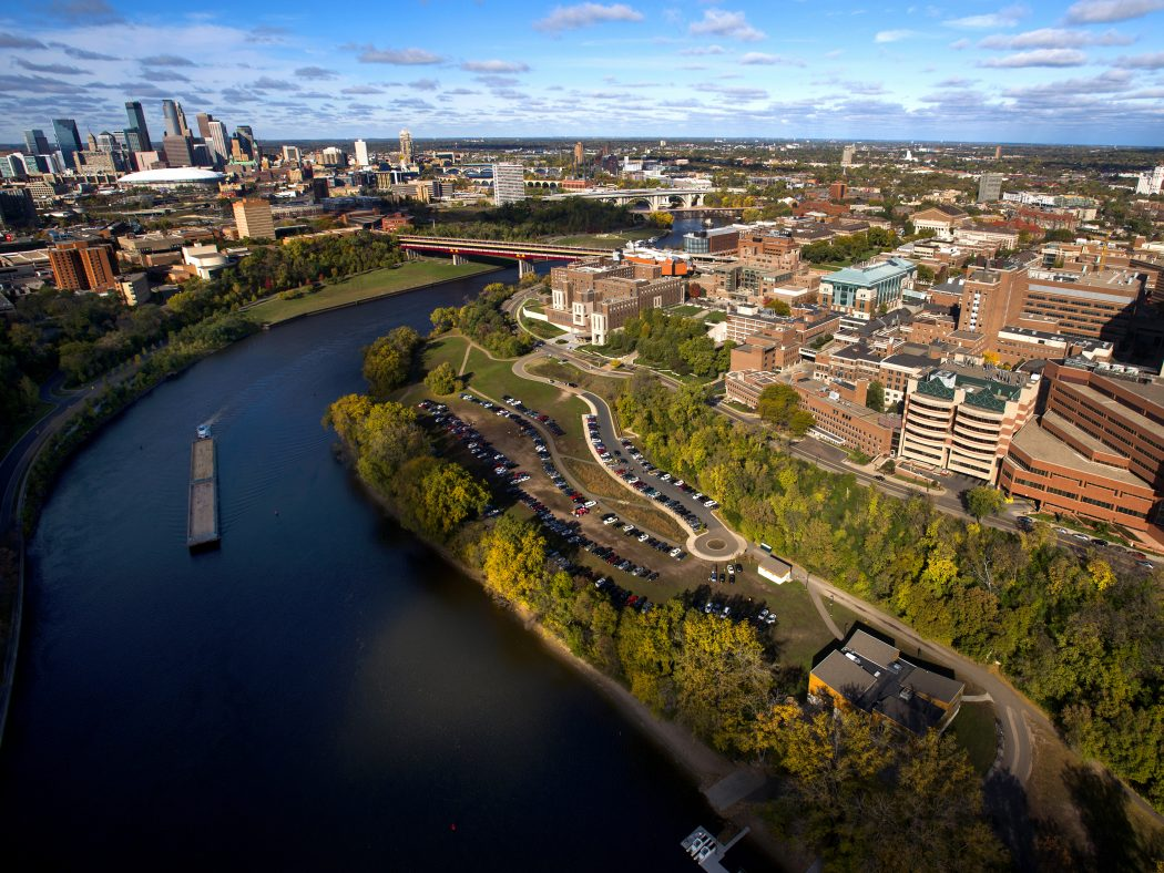 Aerial view of University of Minnesota East and West Bank campuses and the Mississippi River.