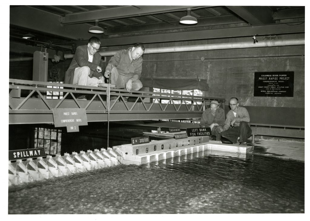 SAFL researchers take measurements of the Priest Rapids physical model. The dam was constructed on the Columbia River in 1961. Image courtesy of SAFL.