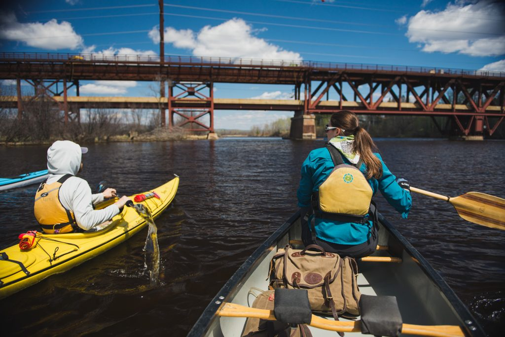 Paddlers make their way down the St. Louis River Estuary near the Oliver Bridge, just south of Duluth, MN. Paddlers in the area are currently working to earn the St. Louis River National Water Trail status. Image courtesy of Alex Messenger Photography.