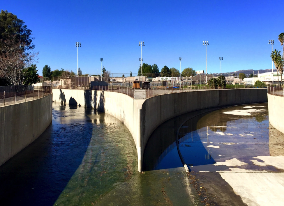 The first stop in Play the LA River: The confluence of Arroyo Calabasas (left) and Bell Creek (right) in Canoga Park, which form the headwaters of the Los Angeles River. The Canoga Park High School athletic field sits just above the confluence, and walking paths line the banks downstream.
