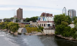 The St. Anthony Falls Laboratory, taken from the Minneapolis Stone Arch Bridge. Photographer Patrick O'Leary. Image courtesy of SAFL.