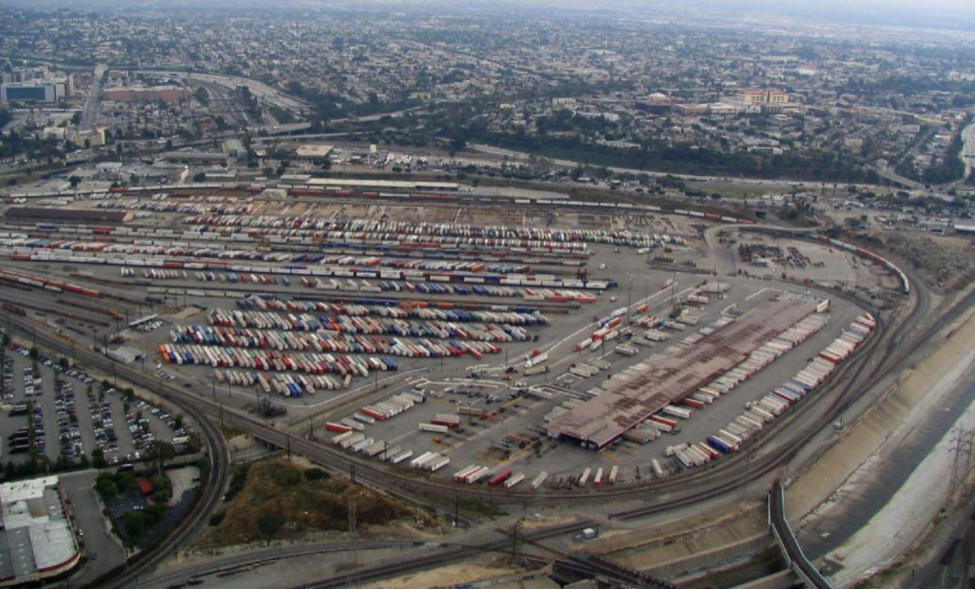 Aerial shot of an industrial area full of shipping containers.
