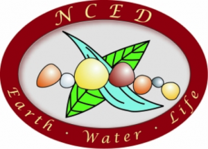 Logo for the NCED. Drawings of stones, a river, and a leaf appear with the words 'Earth, Water, Life' underneath.