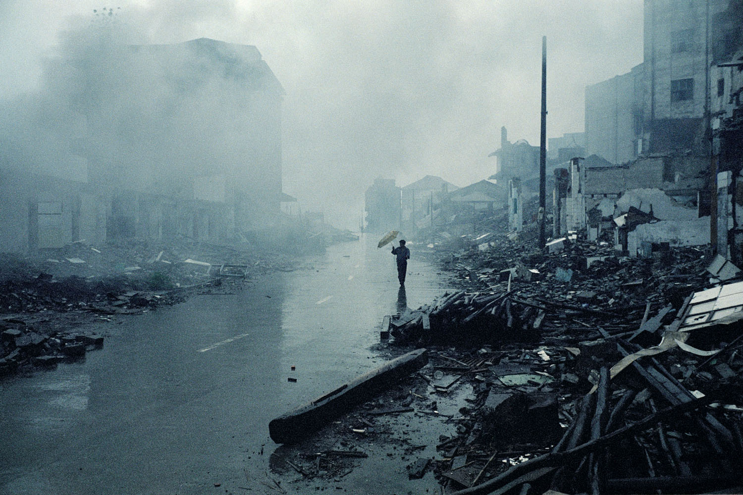 The destroyed old city of Wanzhou, only a few remaining local inhabitants are left behind. Mostly migrant workers remain to dismantle the city by hand and occasionally by using explosives.