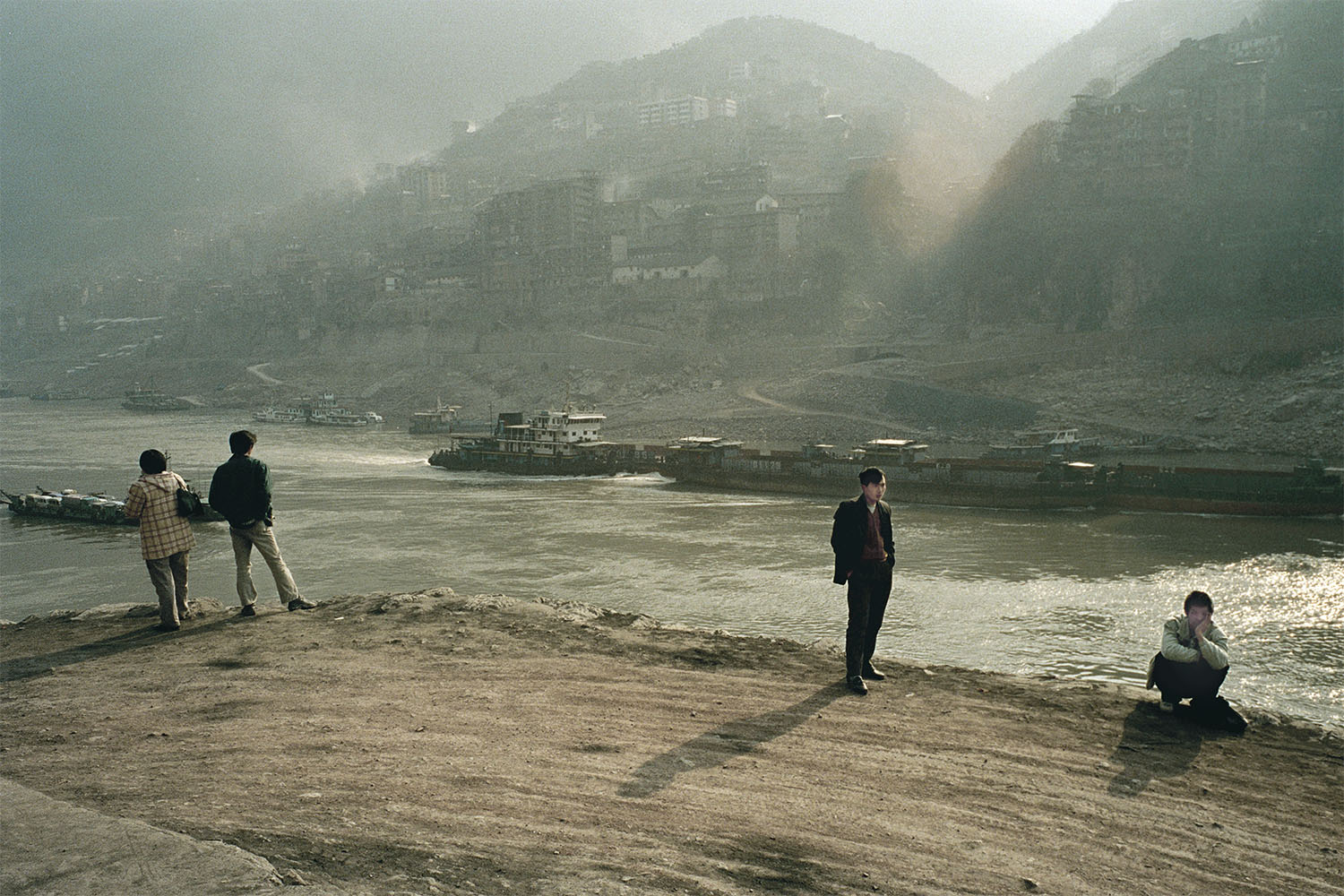Locals looking at Badong, a town that will eventually be two thirds submerged when the Three Gorges Dam is completed. Badong, China. 2002.