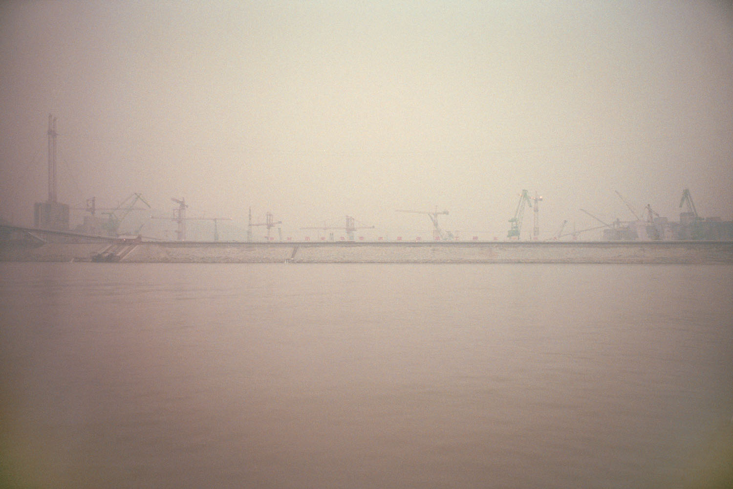 A view of the Three Gorges Dam under construction, a view seen from the Yangtze River. Sandouping, China. 2000.