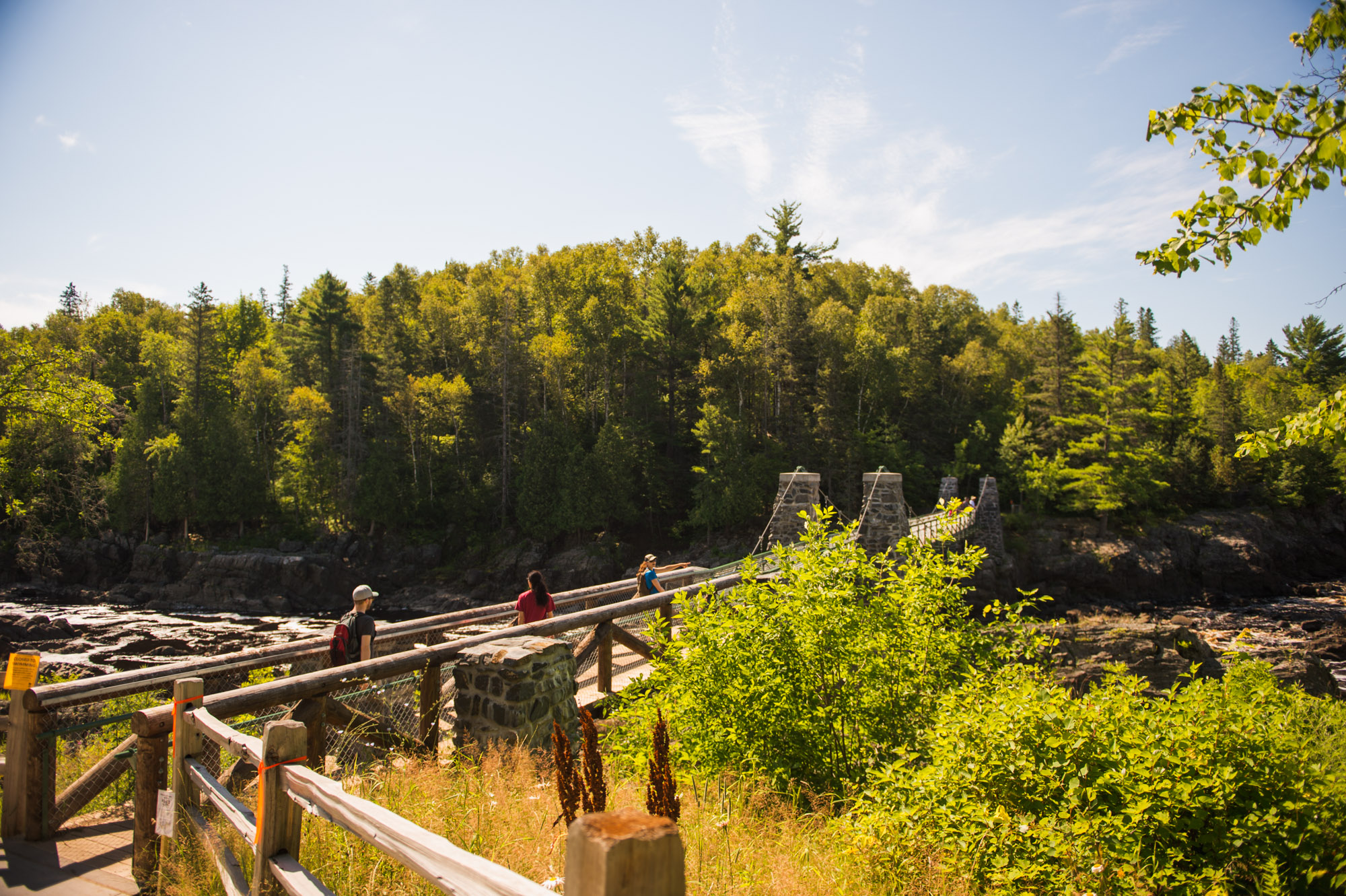 The iconic Swinging Bridge over the St. Louis River at Jay Cooke State Park. Image courtesy of Alex Messenger Photography.