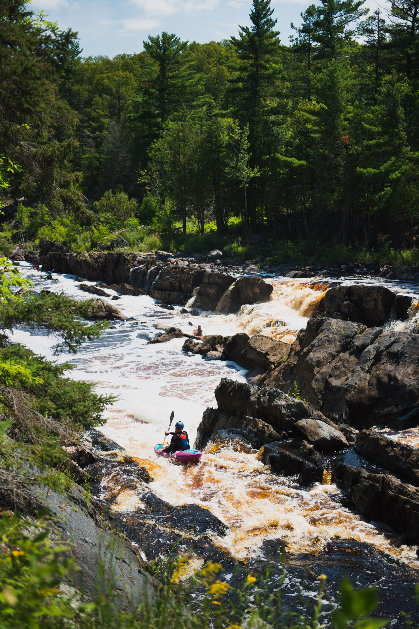 Kayakers paddle the whitewater of the St. Louis River in Jay Cooke State Park. Image courtesy of Alex Messenger Photography.