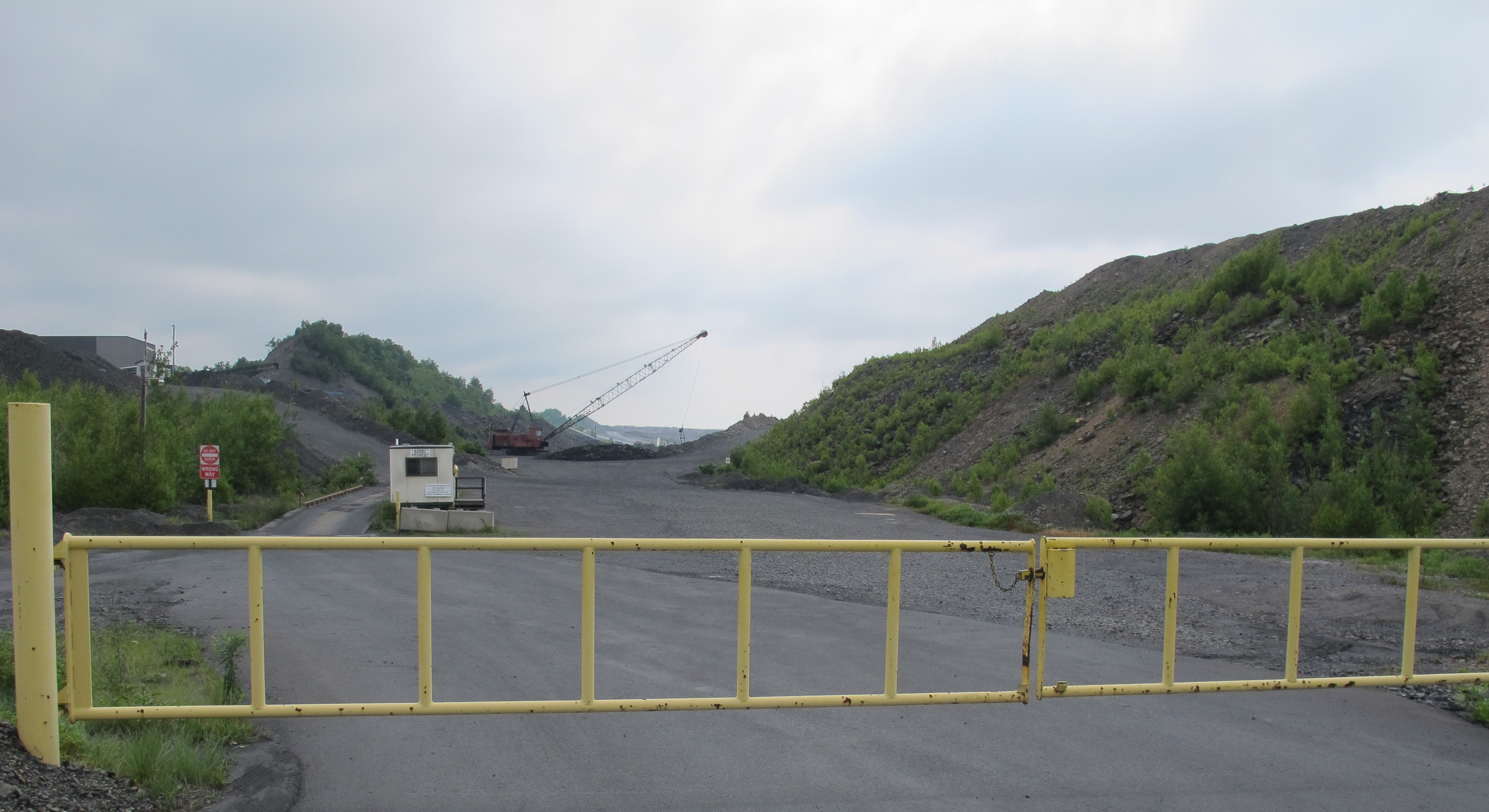 Mining near Stockton, PA, showing the culm banks on both sides of the road. Image by Paul Shackel, 2012.