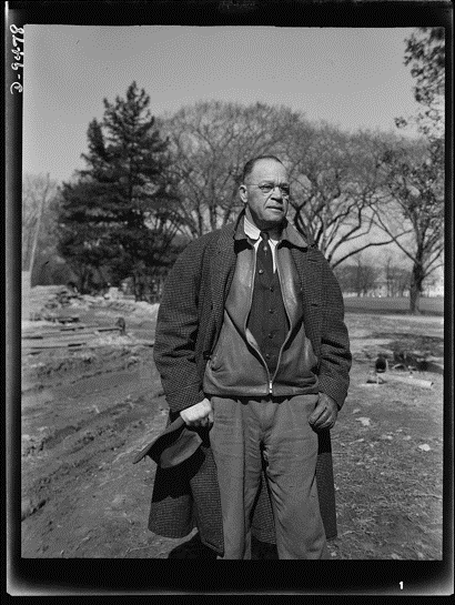 "Figure 5: Archie A. Alexander, senior partner in the firm of Alexander and Repass of Des Moines, Iowa, contractors for the ""million-dollar bridge"" being built across the Tidal Basin in 1943. Roger Smith, photographer. Farm Security Administration, Office of War Information Photograph Collection, Library of Congress."