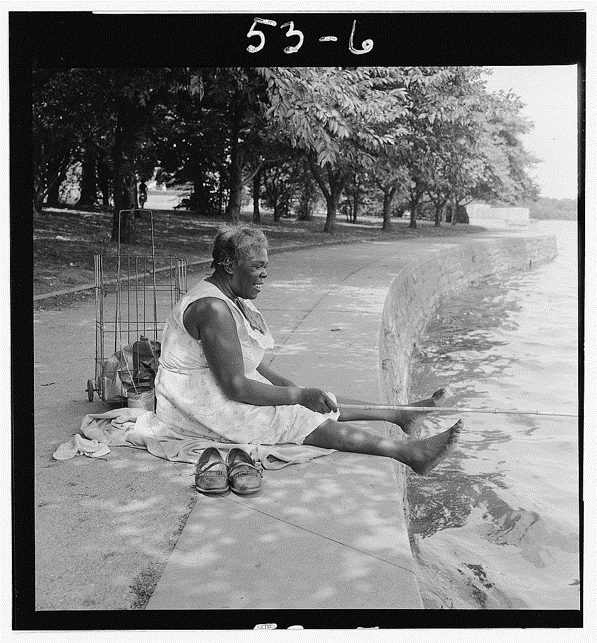 Figure 9: An unidentified African American woman fishing in the Tidal Basin, 1957. Toni Frissell, photographer. Library of Congress Prints and Photographs Division.