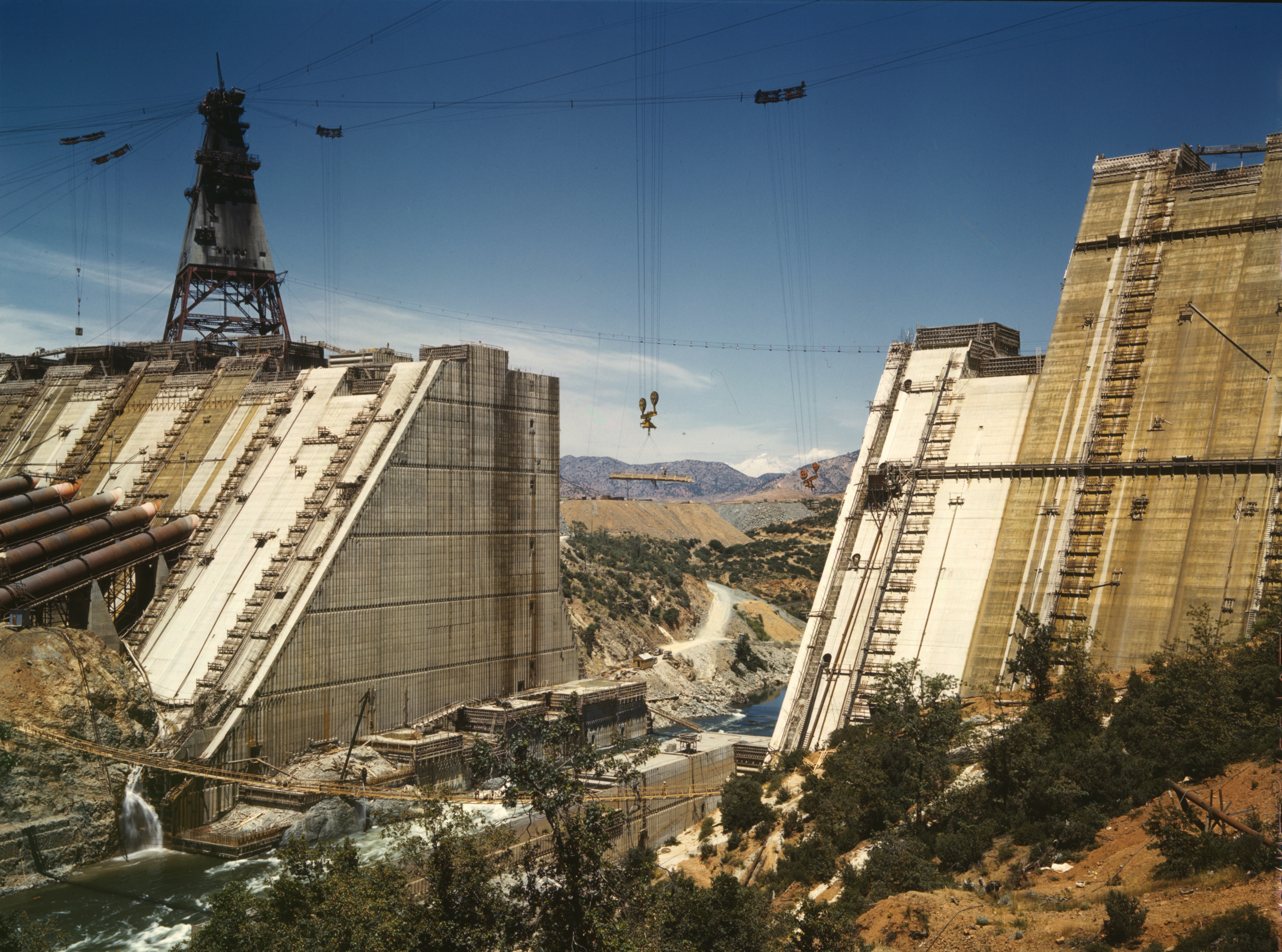 Scholars have associated large water projects like the Shasta Dam, on Northern California's Sacramento River, with their silencing effects on the rivers they impound. Image via Library of Congress.