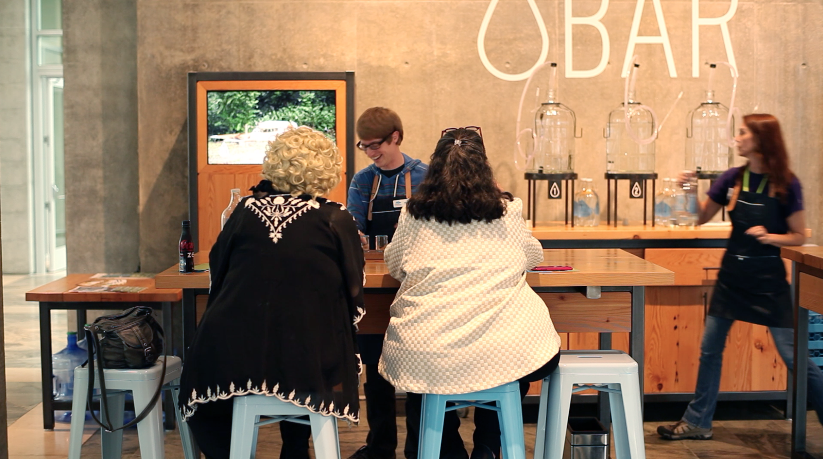 Students serving water at Water Bar installation, Crystal Bridges Museum in Bentonville, Arkansas.