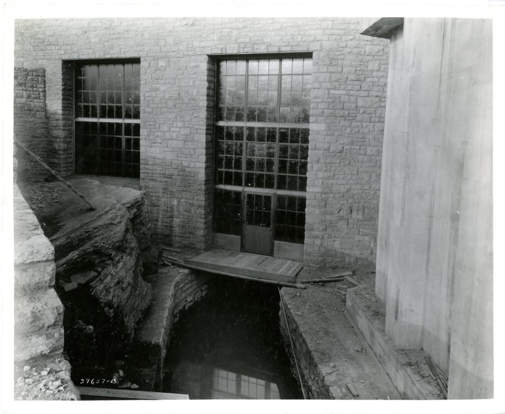 The basement level of the laboratory is constructed over the top of the outflow channel where water exits the building and rejoins the Mississippi River below the falls.