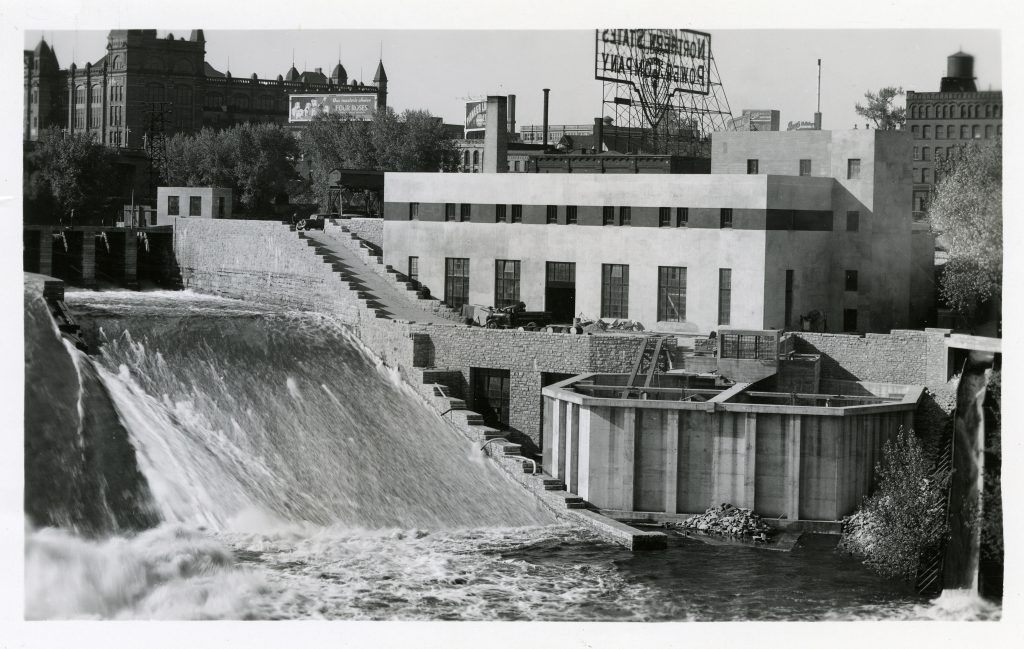 The completed St. Anthony Falls Laboratory in 1938. Notice the volumetric tanks in the foreground, and the city behind the lab.