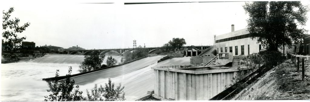 View of the St. Anthony Falls and flood bypass channel alongside the newly completed St. Anthony Falls Laboratory with the volumetric basins visible in the foreground.