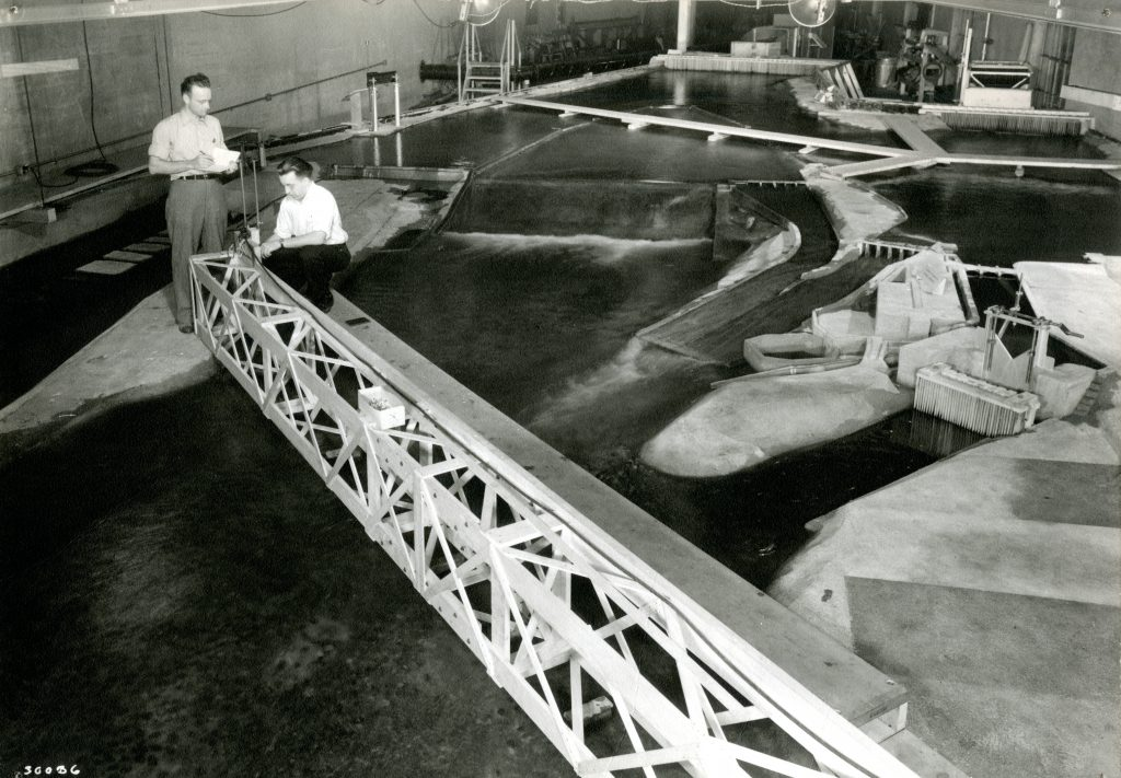 For several years, SAFL hosted a 1:50 scale model of the Mississippi River on its model floor. The model included the stretch of river from the Hennepin Avenue Bridge just upstream of St. Anthony Falls to the Washington Ave Bridge about one mile downstream. The model was built to better understand the potential effects upper and lower dams and locks on the Upper Mississippi would have on navigational conditions.
