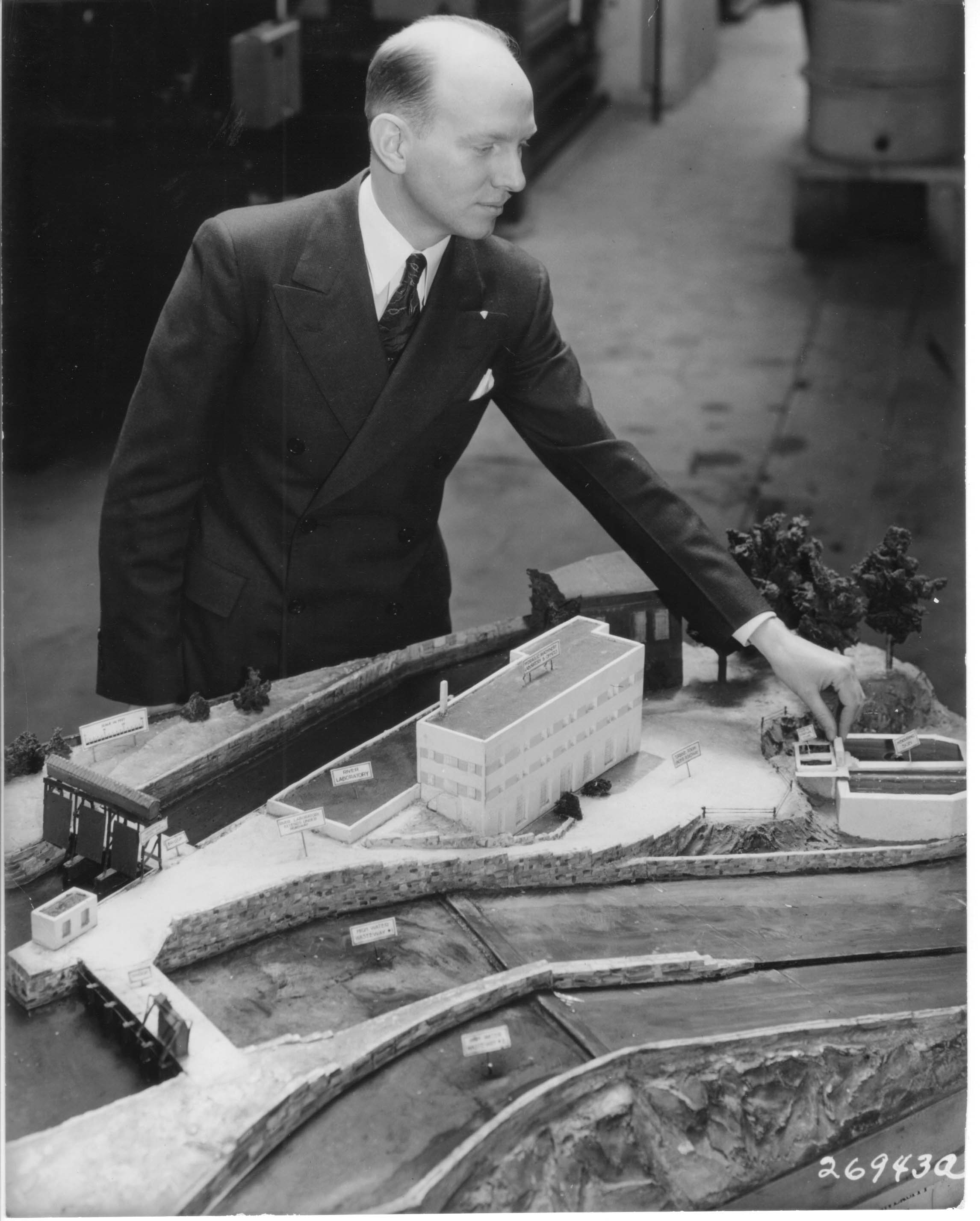 Lorenz Straub with a scale model of the proposed St. Anthony Falls Laboratory. 1937.