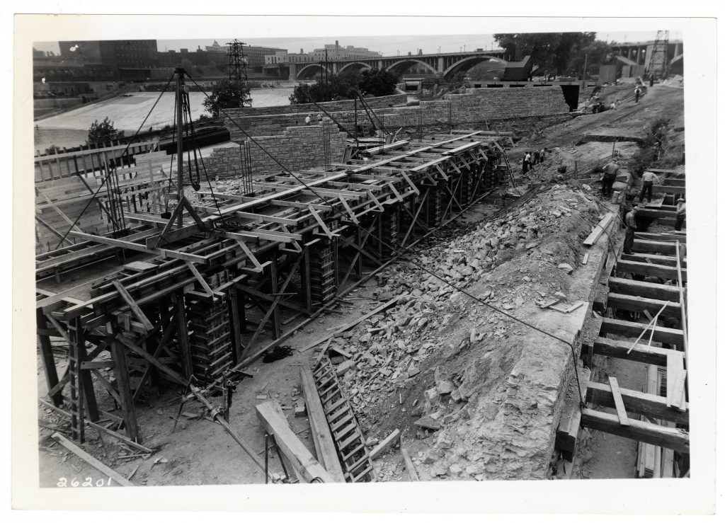 1936 construction of SAFL's supply channel that would divert up to 300 cfs (cubic feet per second) of river water from above St. Anthony Falls through SAFL's experimental facilities. Courtesy of University of Minnesota Archives.