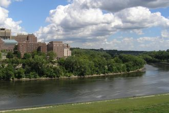 The East Bank of the Minneapolis campus of the University of Minnesota and the Mississippi River from the Washington Avenue Bridge.