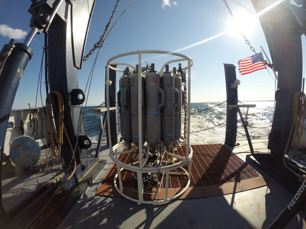 Figure 1. The bottom of Lake Superior is below sea level! To measure certain parameters and to collect water from hundreds of meters below the surface, scientists can deploy this 'CTD rosette.' The gray vertical tubes are water sampling bottles that can be closed at chosen depths so that water from that location is brought back on board. Below the gray tubes is a package of instruments that measures such things as temperature, salinity, oxygen, and other parameters, giving LLO scientists a 'vertical profile' of lake conditions.
