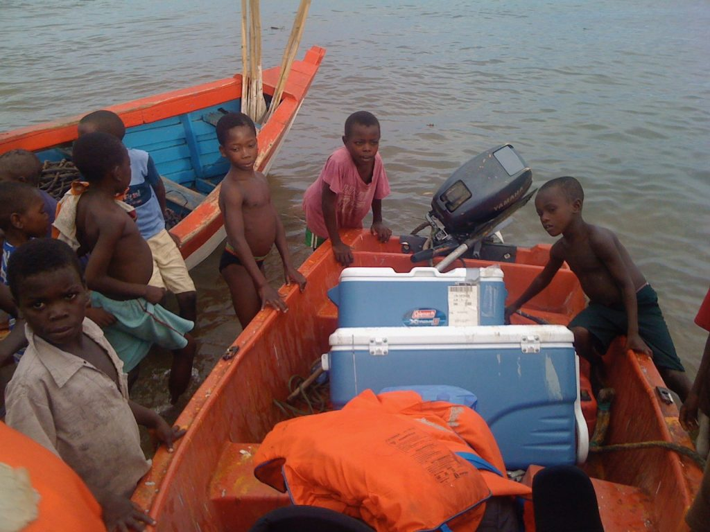 Figure 3. Children are always curious. Here, some LLO scientists working on Lake Malawi came to shore near a fishing market via a dinghy and attracted a crowd.
