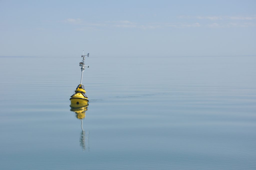 Figure 8. One of LLO's solar-powered buoys on a calm, sunny Lake Superior day, sending data concerning air and water conditions to shore. During the open water season, data from LLO's two buoys (LLO1 and LLO2) are available from http://d.umn.edu/buoys/.