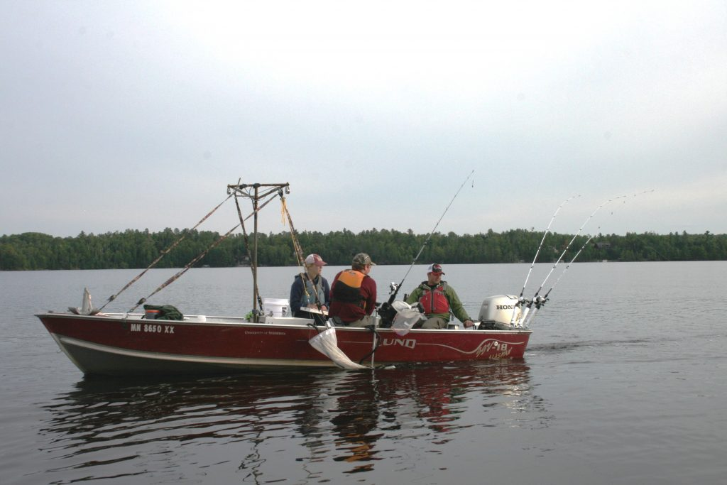 NRRI researchers on Island Lake in northern Minnesota test three different types of fishing line, buoys holding anchor lines and a downrigger to see if spiny water fleas attach to them.