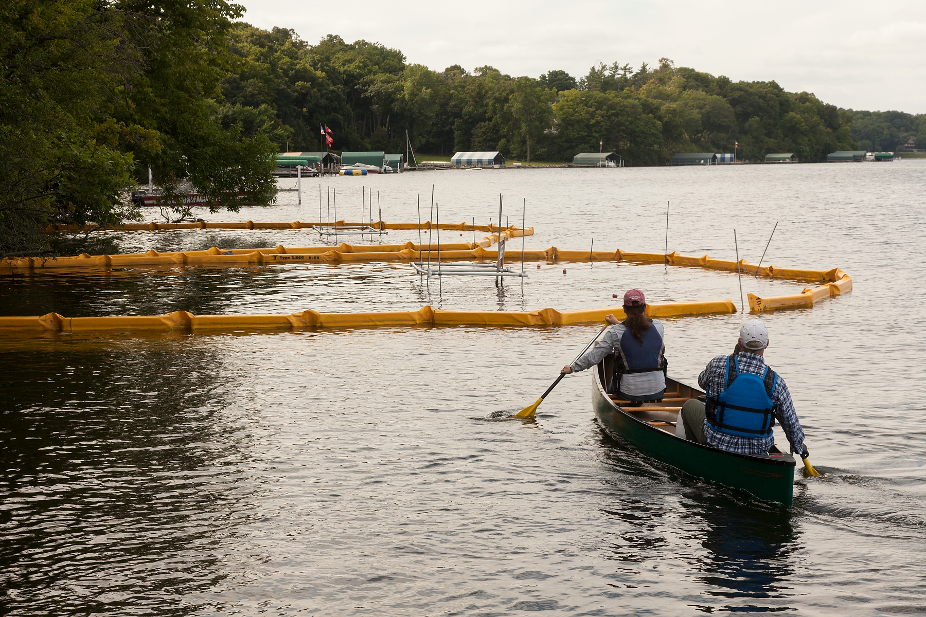 MAISRC researchers Mike McCartney and Sarah Baker paddle to a zebra mussel research site on Lake Minnetonka.
