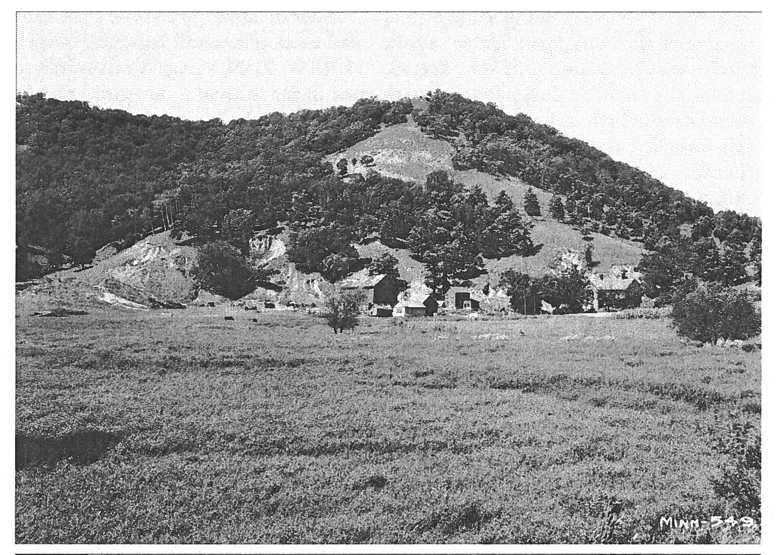 A farm in the Whitewater Valley with a field of what is likely invasive reed canarygrass in the foreground. Image courtesy of Stanley W. Trimble.