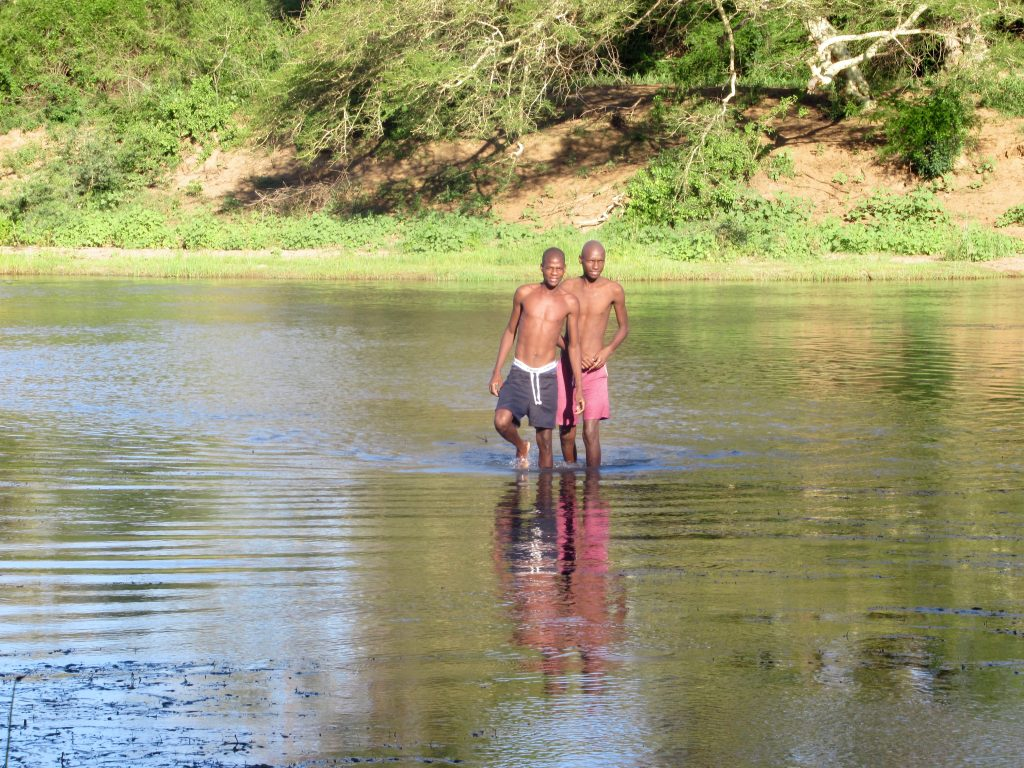 Two local men bathing in the Pongola River. Image courtesy of Shira Lanyi.