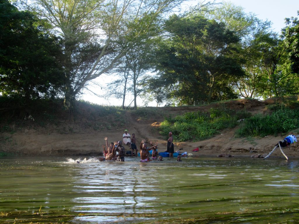 Children playing along the Pongola River. Image courtesy of Shira Lanyi.