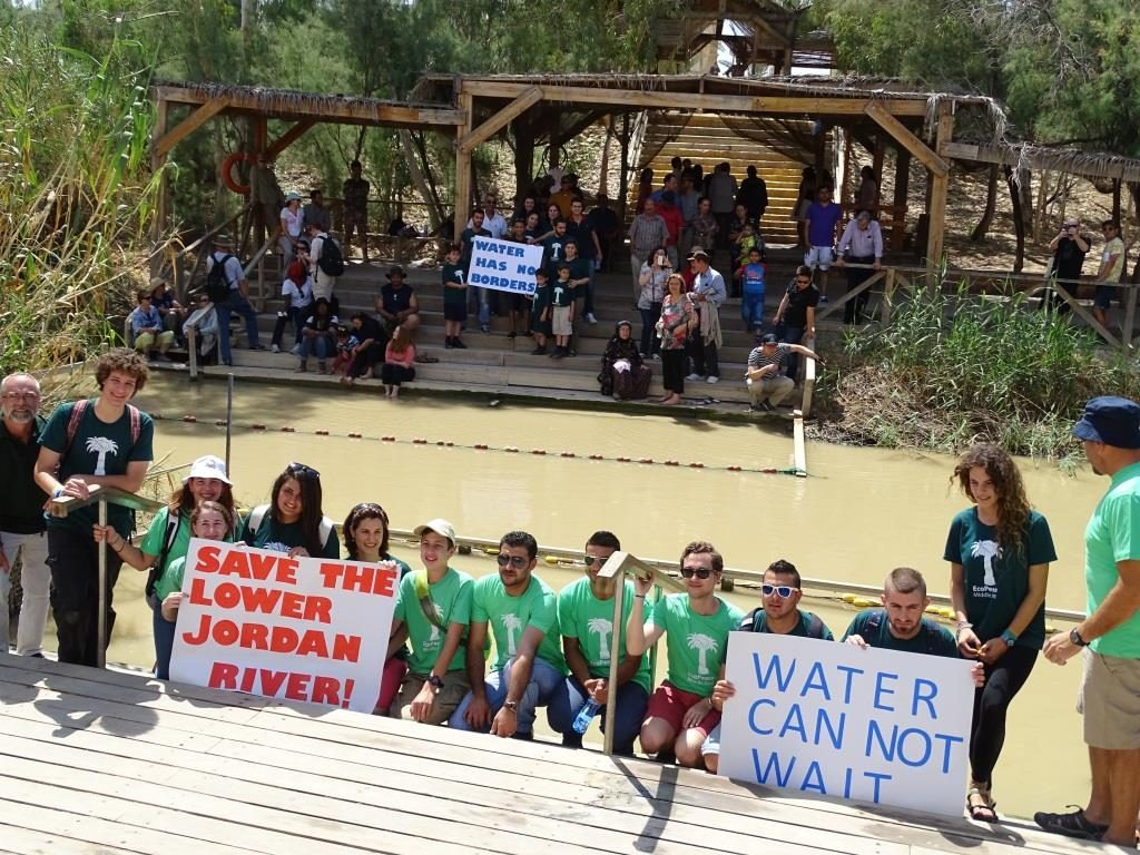 Figure 3. Youth and alumni of EcoPeace Middle East gather at the baptism site on both the Israeli and Jordanian sides of the Jordan River in order to campaign for the river's rehabilitation.