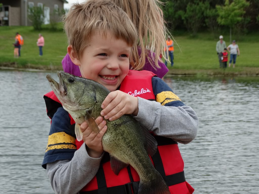 A kid catches a big one at the annual