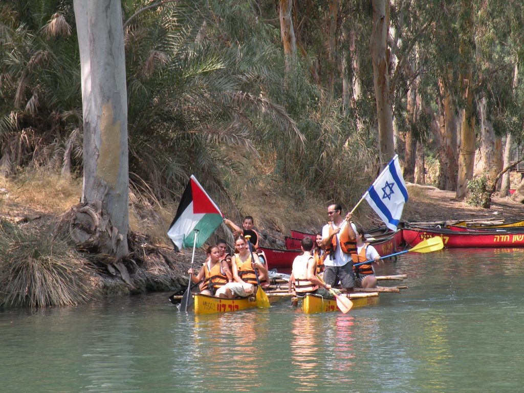 Figure 5. Jordanian, Palestinian, and Israeli youth canoe down the Jordan River. The Jordan River is a valuable part of the shared environmental heritage of the region, and proves the importance of cooperation over transboundary water resources. Image courtesy of EcoPeace Middle East.