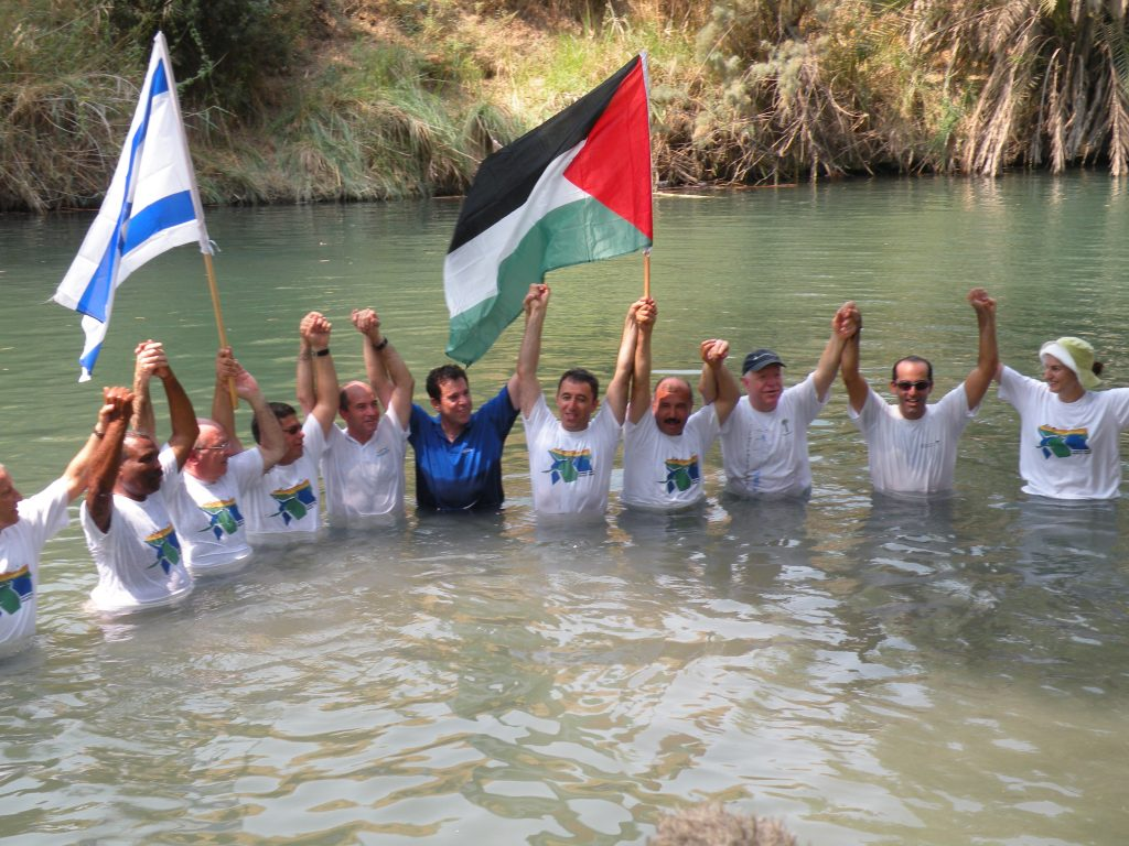Figure 2. Israeli, Palestinian, and Jordanian mayors jump into the Jordan River in 2010, highlighting the importance of the river and its rehabilitation for all peoples and all three religions in the region.